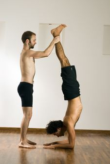 Free Two Men Balancing - Vertical Royalty Free Stock Image - 5640936