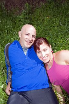 Free Happy Couple Sitting On The Grass - Vertical Stock Photos - 5641053