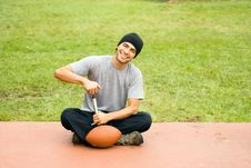 Free Man In Park Pumping Air Into Football - Horizontal Royalty Free Stock Photos - 5641108