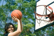 Woman Playing Basketball At Park - Horizontal Royalty Free Stock Image