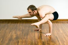 Free Man In A Yoga Crouch - Horizontal Stock Photography - 5641242