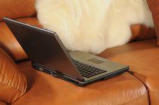 Laptop On A Sofa Royalty Free Stock Photos