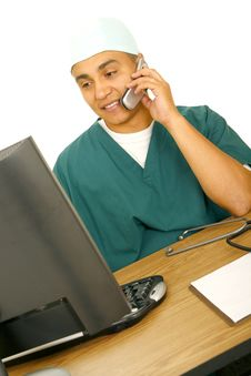 Free Nurse Calling And Looking At Screen Royalty Free Stock Photos - 5643788