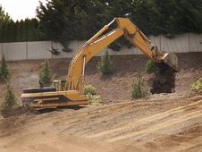 Free Excavator Dumps Dirt Royalty Free Stock Photo - 5647865