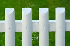 Free White Picket Fence Over Green Grass Royalty Free Stock Images - 5648509
