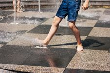 Free Feet Of Boy Playing In The Fountain Stock Photos - 56418143