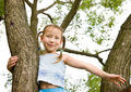 Free Cheerful Girl On A Tree Stock Photo - 5659730