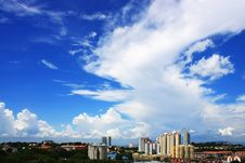 Free Cityscape Over Cloudy Blue Sky Stock Photo - 5651980