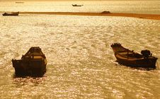 Fishing Boat Under The Setting Sun Stock Images