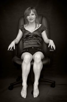 Free Young Woman In Armchair Barefooted Stock Photo - 5654780
