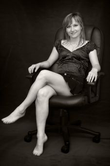 Free Young Woman In Armchair Barefooted Stock Photos - 5654783