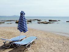 Free Beach Under A Blue Sky Royalty Free Stock Photo - 5656075