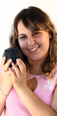 Young Lady Holding Piggy Bank Stock Image