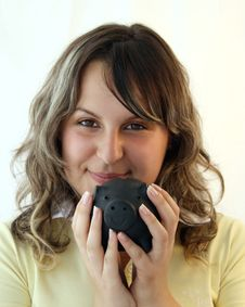 Young Lady Holding Piggy Bank Royalty Free Stock Image