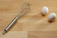 Free Whisk And Eggs Royalty Free Stock Photography - 5656887