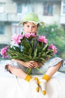 Girl On Windowsill Royalty Free Stock Photography