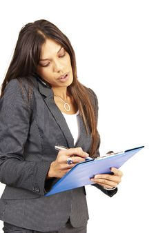 Beautiful Brunette Woman Holding A Clipboard Stock Photo