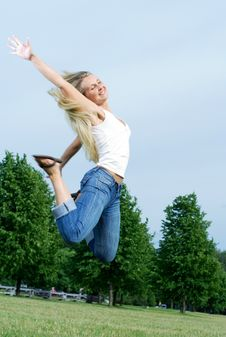 Free Happy Jumping Woman. Royalty Free Stock Photography - 5661267