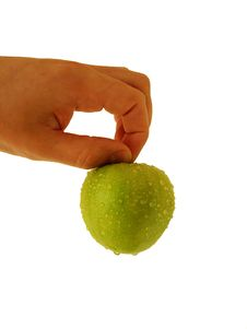 Green Apple At Hand Royalty Free Stock Photography