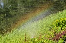 Rainbow In The Pond Royalty Free Stock Photography
