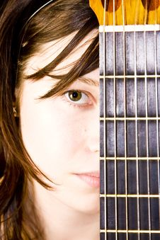 Woman Behind Fretboard Royalty Free Stock Photos