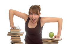Young Woman And Pile Of Books Stock Images