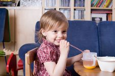 Little Girl Drinking Fresh Orange Juice Stock Photo