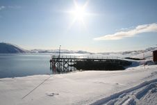 Arctic Sun Behind The Dock Stock Image