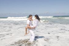 Free Man And Woman Playing In The Seaside Stock Photo - 5678320
