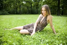 Free Woman Laying On A Grass Stock Image - 5678841
