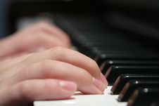 Fingers On The Piano Keyboard Stock Photo