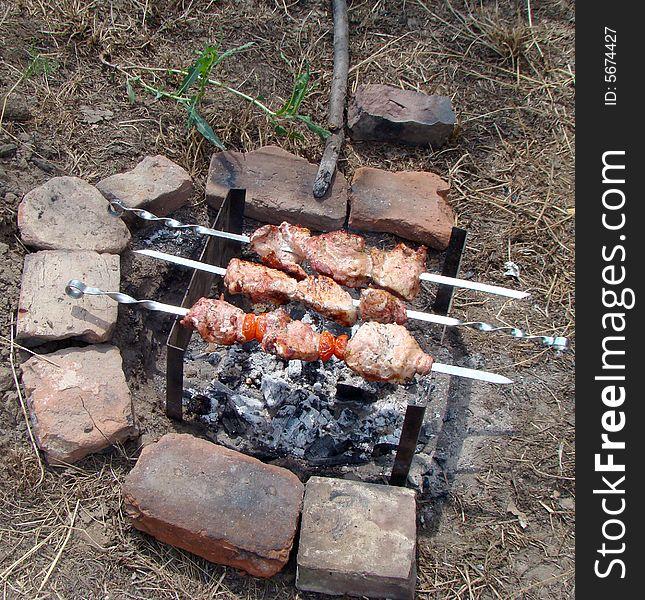 Preparation of shashlik on mangal