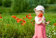Baby-girl With Poppies Royalty Free Stock Photo