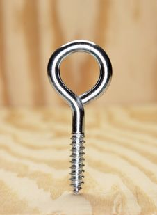 Eye Hook In Plywood Royalty Free Stock Image