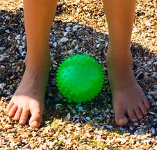 Free Child Feet On Sand At Green Ball Royalty Free Stock Photography - 5683447