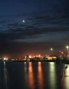 Fishing Village Reflections At Night Stock Photo