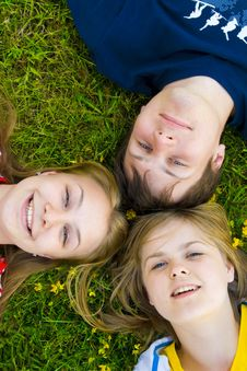 Free Three Friends Lay On A Grass Stock Images - 5686344