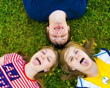 Free Three Friends Lay On A Grass Royalty Free Stock Photography - 5686377
