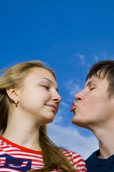 Free Kissing Couple On A Background Of The Blue Sky Royalty Free Stock Images - 5686459