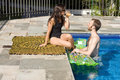 Free Couple In And Beside Pool - Horizontal Royalty Free Stock Images - 5698429