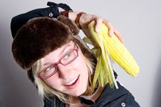 Free Young Woman Staring At Cob Of Corn. Royalty Free Stock Photography - 5690047