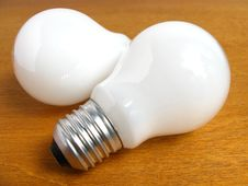Free Two Light Bulbs On Wood Royalty Free Stock Image - 5691566