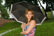 Free Girl Under A Umbrella Royalty Free Stock Photography - 5692277