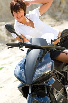 Free Pretty Model With Black Motorcycle Stock Photography - 5692992