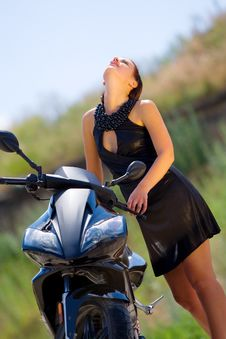 Free Pretty Model With Black Motorcycle Royalty Free Stock Photo - 5693165