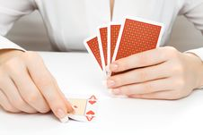 Woman Putting Card On The Table Stock Photo