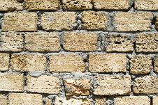 Wall From A Rough Yellow Brick Royalty Free Stock Image