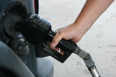 Free Man Pumping Gas Stock Photos - 5694923