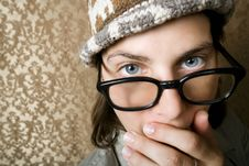 Nerdy Woman In A Knit Cap Covering Her Face Stock Photos