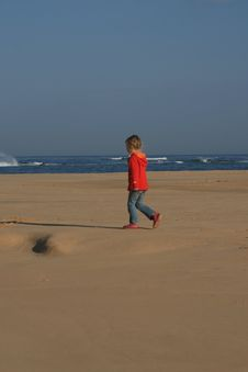 Free Kid Walking Alone On The Beach Royalty Free Stock Image - 5696316